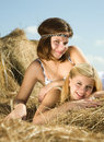 Country girls on hay Royalty Free Stock Photo
