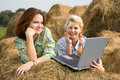 Country girls resting with laptop Stock Photos