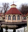 Country house in classical style a verandah the center of the small lake Royalty Free Stock Images
