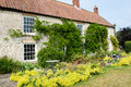 Country house with garden traditional stone built Royalty Free Stock Photography