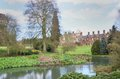 Country house in large  formal gardens Royalty Free Stock Photo