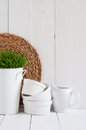 Country kitchen decoration cottage life a house plant in a metal pot pottery utensils and napkins on white painted board Royalty Free Stock Photography