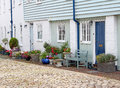 Country mews cottages photo of kent with cobbled path and pretty potted flowers and plants Royalty Free Stock Photography
