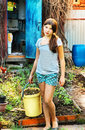 Country portrait of teenager beautiful girl with bin Royalty Free Stock Photo