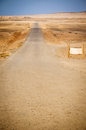 Country road, blank billboard and desert landscape Stock Photography