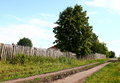 Country road fence and kitchen gardens Royalty Free Stock Photos