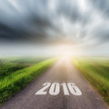Country road on field and storm clouds or rainclouds forward to the new year Royalty Free Stock Photography