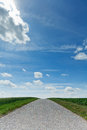 Country road with horizon Stock Images