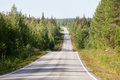 Country road in Lapland, Finland, on a sunny summer day Royalty Free Stock Photo