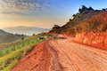 Country road leading into the morning sun rural of chiangmai thailand Stock Images