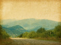 Country road mountains photo retro style paper texture Royalty Free Stock Image