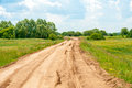 Country road in summer on landscape background Royalty Free Stock Photo