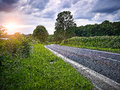 Country road at sunset cloudy backlite shot peferct for car copy space Royalty Free Stock Photography