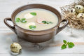 Country sour soup made ​​of fresh ingredients on old wooden table Stock Image