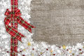 Country style christmas background with red green checked ribbon Royalty Free Stock Photo