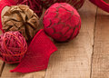 Country style christmas ornaments on rustic wood with copyspace horizontal of made of fibers in red and brown a red jute ribbon Stock Image
