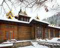 Country wooden house and winter forest Stock Photography