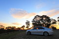 Countryside car at sunset a scenic drive through the australian hill end with a stop the top of a hill by Royalty Free Stock Image