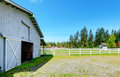 Countryside horse farm country with wooden fence and stable Royalty Free Stock Photography