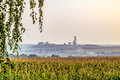 Countryside landscape with an iron ore mine on the smoky horizon Royalty Free Stock Photo