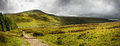 Countryside landscape panorama across to mountains Royalty Free Stock Image