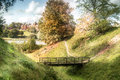 Countryside landscape peaceful summer with a small bridge in the foreground Stock Photo