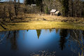 Countryside landscape with a pond and a shed in early spring Royalty Free Stock Photos