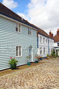 Countryside mews cottages photo of kent with pretty flower boxes and cobbled stone path Royalty Free Stock Images