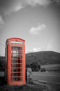 Countryside red phone box british booth in a black and white rural setting Stock Image