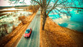 Countryside road and red car Royalty Free Stock Photo