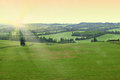 Countryside sunset scenic view of green wooded at Royalty Free Stock Image