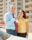 Couple against building new brick house Stock Images