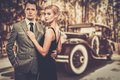 Couple against vintage car beautiful retro Royalty Free Stock Photography