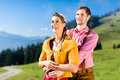 Couple on alp mountain summit at vacation in tracht Royalty Free Stock Photos