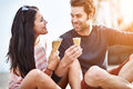 Couple at amusement park sharing ice cream photo of a Royalty Free Stock Photos