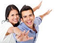 Couple with arms open Stock Images