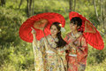 Couple asian women wearing traditional japanese kimono and red umbrella in the himalayan sakura garden thailand Royalty Free Stock Photography