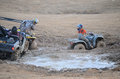 Couple of ATV's Stuck in the Mud Royalty Free Stock Photography