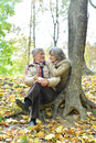 Couple in autumn park portrait of a mature Royalty Free Stock Photos