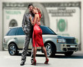 Couple backdrop car, money. Stock Image
