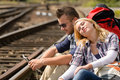 Couple backpack traveling resting on railroad map Royalty Free Stock Photos