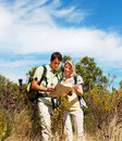 Couple with  backpacks looking at a map Stock Photography