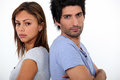 Couple in a bad mood stood back to back Stock Image
