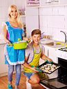 Couple baking cookies in the oven happy famiy Royalty Free Stock Photo