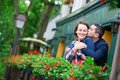Couple on balcony with blossoming geranium men kissing his girlfriend Stock Images