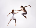 Couple of ballet dancers on a light background Royalty Free Stock Photo