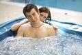 Couple bathing at jacuzzi Stock Photos