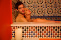 Couple in the bathtube looking at camera Royalty Free Stock Photos