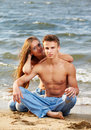 Couple at the beach Stock Photos