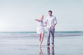Couple on beach in honeymoon vacation white clothing running down or Stock Photos